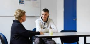 Male VET student receiving Mentoring from Centacare Employee