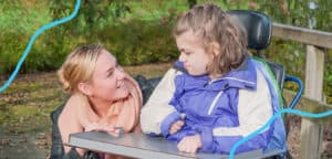 An interaction between a child with disability and support worker