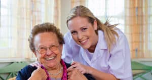 Aged care worker being responsible with older woman.
